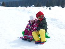 Portrait of boy and baby girl on winter vacation Stock Image