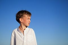 Portrait of boy on background of blue sky Royalty Free Stock Photos