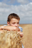Portrait of a boy on the background of rural Royalty Free Stock Photos