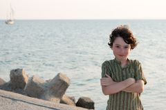Portrait of a boy on the background of the sea. Royalty Free Stock Photo