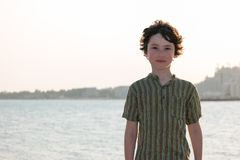 Portrait of a boy on the background of the sea. Royalty Free Stock Images