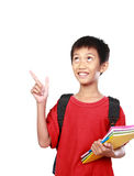 Portrait of boy with backpack pointing Stock Image
