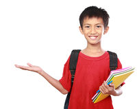 Portrait of boy with backpack presenting Royalty Free Stock Images