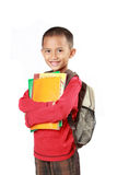 Portrait of boy with backpack smiling Royalty Free Stock Photos