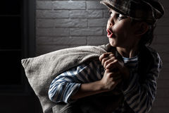 Portrait of a boy with a bag thief Royalty Free Stock Photography