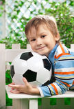 Portrait of boy with ball in a garden Stock Photography