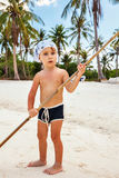Portrait of a boy with a bamboo stick Royalty Free Stock Photos