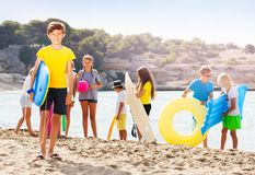 Portrait of boy on a beach with friends Stock Photos