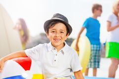 Portrait of the boy on beach and his friends Royalty Free Stock Photo