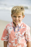Portrait of boy on beach smiling Royalty Free Stock Photo