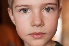 Portrait of a boy with beautiful eyes close-up royalty free stock images