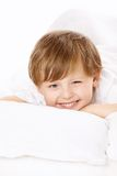 Portrait of boy in bed Royalty Free Stock Photography
