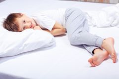 Portrait of a boy in bed with pajama Royalty Free Stock Photo