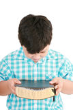 Portrait of a boy with a Bible in hand  and prayed Royalty Free Stock Image