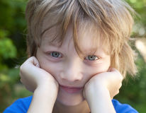 Portrait of a Boy with Blond Hair Looking Royalty Free Stock Images