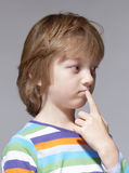 Portrait of a Boy with Blond Hair Thinking Stock Image