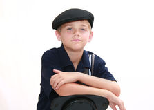Portrait of Boy in Blue. Portrait of handsome young boy  in blue with newsboy cap, isolated on white Stock Images
