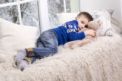 Portrait of a boy in a blue sweater stock images