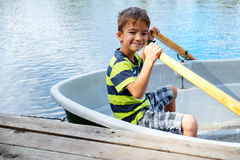 Portrait of a boy in a boat Royalty Free Stock Images