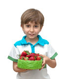 Portrait of a boy with a bowl of strawberries in t Stock Photo