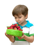 Portrait of a boy with a bowl of strawberries in t Royalty Free Stock Images