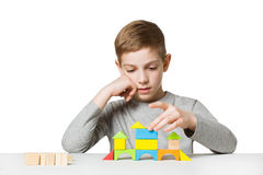 Portrait of a boy building house made of wooden blocks Royalty Free Stock Photography