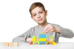 Portrait of a boy building house of wooden blocks Stock Image