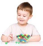 Portrait of a boy with candies Stock Photo