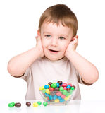 Portrait of a boy with candies Stock Image