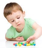 Portrait of a boy with candies Stock Photography