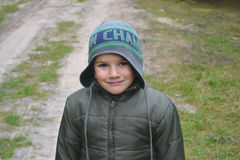Portrait of a boy. In a cap autumn children royalty free stock images