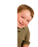 Portrait of boy child peeking around corner. Portrait of happy young boy child peeking around corner isolated on white Stock Photography