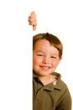 Portrait of boy child peeking around corner. Portrait of happy young boy child peeking around corner isolated on white Stock Images