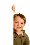 Portrait of boy child peeking around corner Stock Images