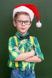 Portrait of a boy in the Christmas cap near a school board Stock Photography