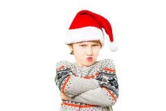 Portrait of a boy in christmas hat with angry and Royalty Free Stock Image