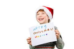 Portrait of a boy in christmas hat holding blank Royalty Free Stock Photography