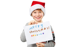 Portrait of a boy in christmas hat holding blank Stock Photography