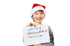 Portrait of a boy in christmas hat holding blank Stock Image