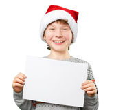 Portrait of a boy in christmas hat holding white Stock Image
