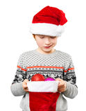 Portrait of a boy in christmas hat holdink white Royalty Free Stock Photography