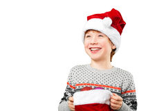 Portrait of a boy in christmas hat holdink white Stock Images