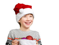 Portrait of a boy in christmas hat holdink white Stock Photos