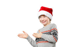 Portrait of a boy in christmas hat pointing at Royalty Free Stock Image