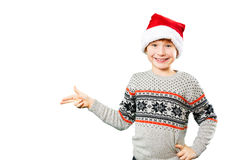 Portrait of a boy in christmas hat pointing at Stock Photo