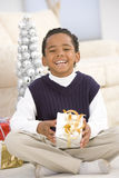 Portrait Of Boy With Christmas Present Royalty Free Stock Photos