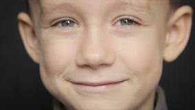 Portrait of a boy close-up on a black background. Portrait of a boy close up. Full hd video stock video footage