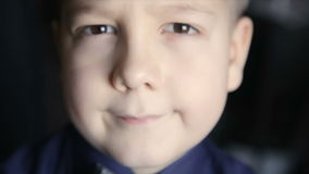 Portrait of a boy close-up on a black background. Full hd video stock video