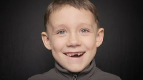 Portrait of a boy close-up on a black background. Full hd video stock video footage