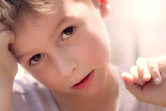 Portrait of a Boy. Close up portrait of a young caucasion boy with sun in the background Royalty Free Stock Image